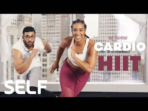 30 Minute HIIT Cardio Workout + Abs At Home – With Warmup | SELF